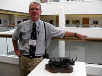 Stephen C. Quinn with his Black Rhino sculpture, 2010.